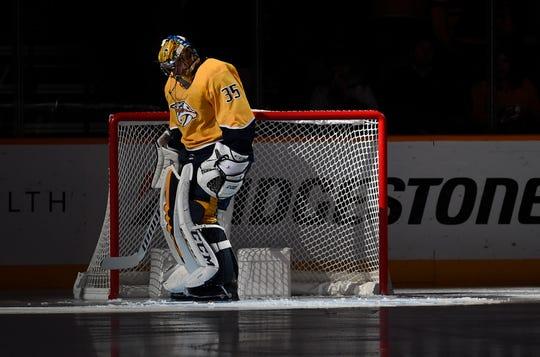 Nashville Predators goaltender Pekka Rinne (35) has the spotlight on him during introductions before the game against the Calgary Flames at Bridgestone Arena Thursday, Oct. 31, 2019 in Nashville, Tenn.