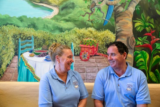 New owners pose for a portrait at Sunburst Cafe on Wednesday, October 2, 2019, in Naples.