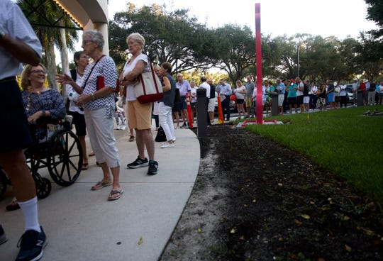 "Dozens of people wait in line for their opportunity to buy Hamilton tickets at Artis-Naples on November 1, 2019. More than 350 people arrived early in the morning to purchase their tickets for the January showing, with the earliest patron arriving at 5:30am. ""I've never seen anything like it,"" said Ashley Mirakian, Vice President of Marketing at Artis-Naples."