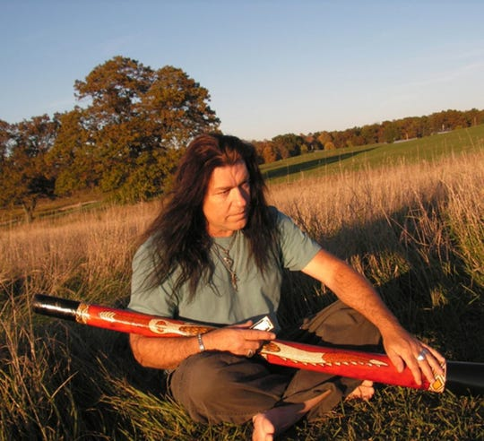 Peter Harper includes sounds from the Australian instrument, the didgeridoo, in some of the blues music he performs.