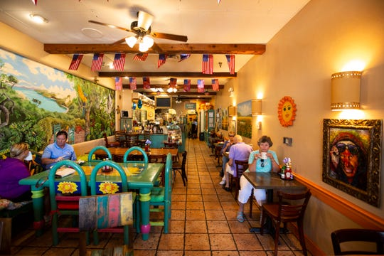 Customers enjoy their time at Sunburst Cafe on Wednesday, October 2, 2019, in Naples.