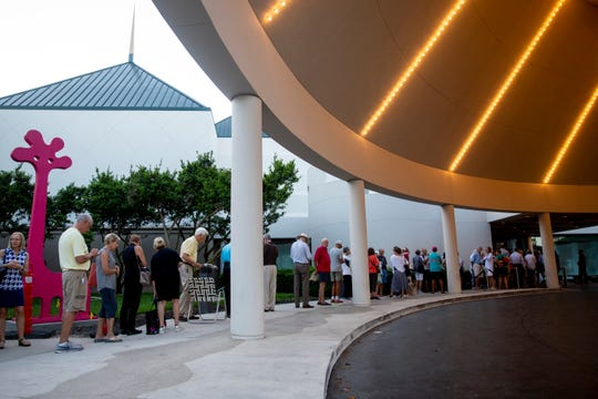 Dozens of people wait in line for their opportunity to buy Hamilton tickets at Artis-Naples on Friday, November 1, 2019. More than 350 people arrived early in the morning to purchase their tickets for the January showing, with the earliest patron arriving at 5:30am. ÒIÕve never seen anything like it,Ó said Ashley Mirakian, Vice President of Marketing at Artis-Naples.