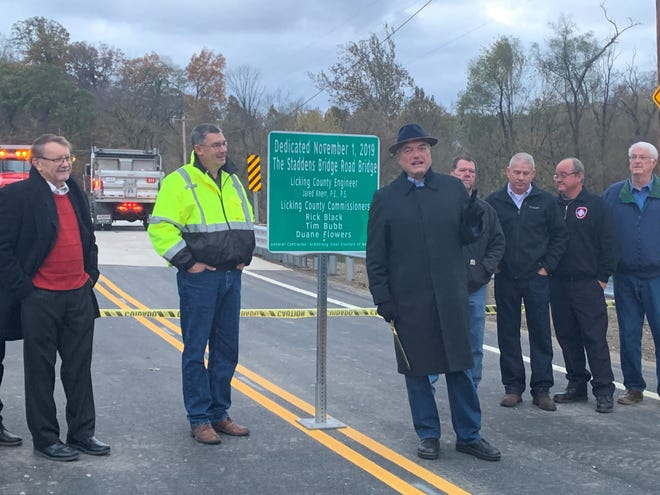 Licking County Commissioner Tim Bubb addresses a crowd ahead of a ribbon cutting ceremony for Staddens Bridge on Friday, Nov. 1, 2019. The bridge was closed for replacement beginning in 2018.