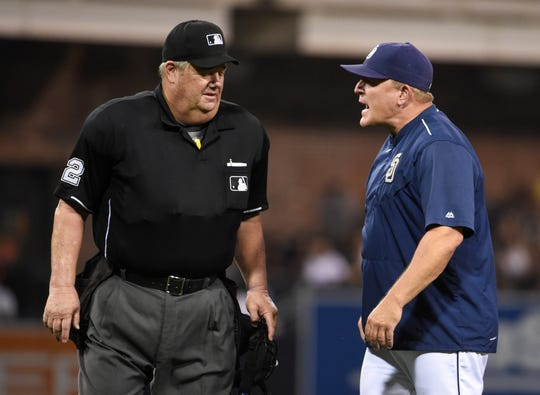 Interim manager Pat Murphy #24 of the San Diego Padres argues a call with umpire Joe West during the fifth inning of a baseball game against the San Francisco Giants at Petco Park September 24, 2015 in San Diego, California.