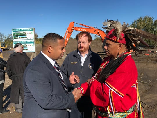 Passaic Mayor Hector Lora meets with Vincent Mann, the Turtle Clan chief of the Ramapough Lenape Nation, as Freeholder director John Bartlett looks on.