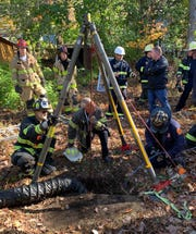 Rescue workers pull a woman out of a well on her property in Hillsdale. Oct. 21, 2019