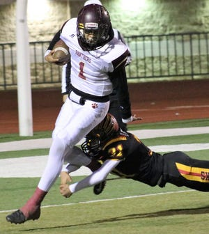 Gadsden's Anthony Lara tries to slip by Centennial's Diego Martinez during a District 3-6A matchup Thursday night at the Field of Dreams.