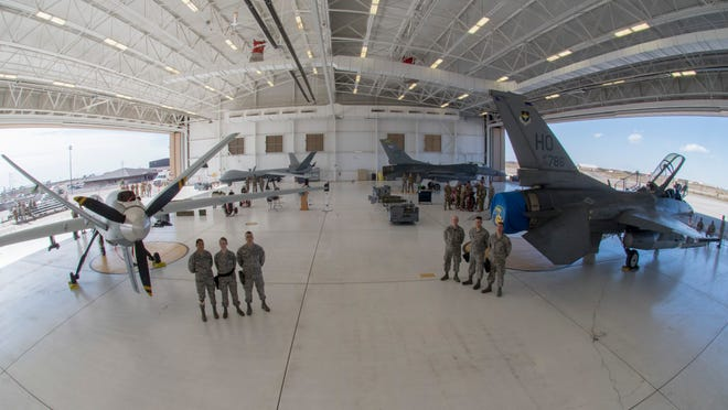Airmen from the 49th Maintenance Group pose for a photo before the beginning of a load competition, Oct. 28, 2019, on Holloman Air Force Base, N.M. Two F-16 Vipers and two MQ-9 Reapers were used to test the loading skills of 12 Airmen during the 2019 third quarter load competition.