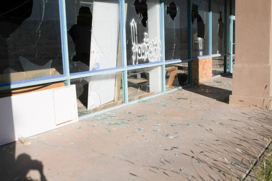 Glass on the ground from the windows of the old video store next to the Medlin Ramps facility at 1900 Highway 54 South.