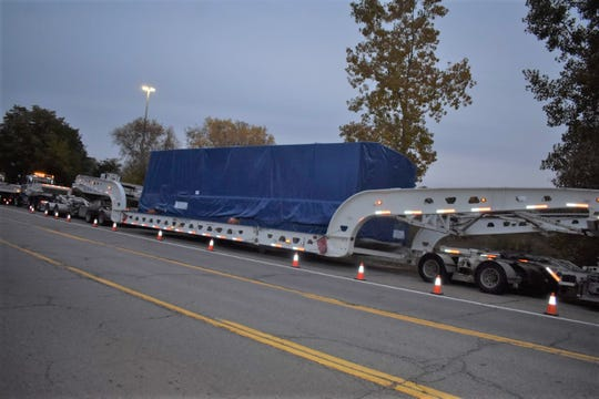 The flatbed trailer carrying the compressors is 170 feet long.