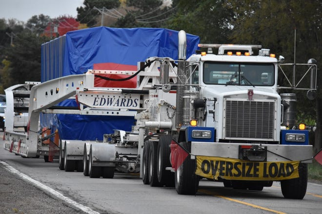 The 200,000-pound compressor is hauled along Haggerty Road