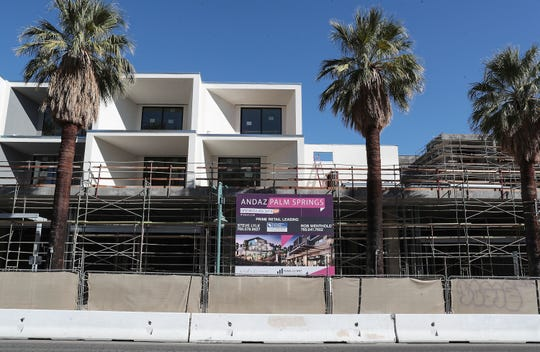 A sign indicates that the Andaz Palm Springs project will be open in late 2019, however work has stalled on the downtown Palm Springs hotel, November 1, 2019.