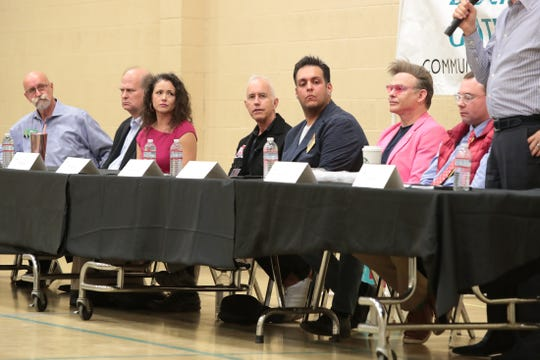 Palm Springs City Council candidates Les Young, left, Scott Myer, Grace Garner, Dennis Woods, Adrian Alcantar, Alan Pettit, Michael Dilger and Geoff Kors participate in a forum at the Jessie O. James Desert Highland Unity Center in Palm Springs, Calif., on Tuesday, October 29, 2019.