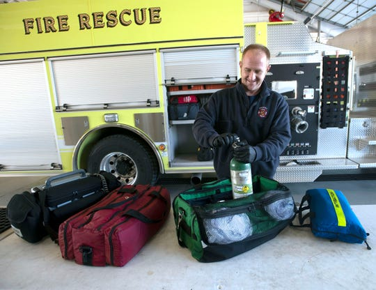 Midway firefighter Levi Alderfer restocks the medical supplies usesd on one of  the department's fire trucks on Friday, Nov. 1, 2019. The Midway Fire District is looking to double its workforce and add two news stations to protect the Midway area over the next seven years.