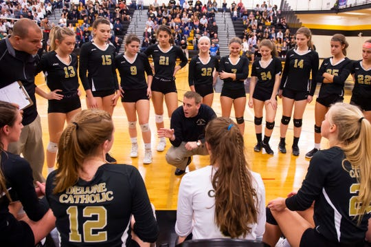 Delone Catholic head coach Jason Leppo talks with the Squirettes during a timeout in a District III Class 2A semifinal match against York Catholic at Red Lion on Thursday, Oct. 31, 2019. The Squirettes won in four sets; 25-21, 25-18, 24-26, 25-19.