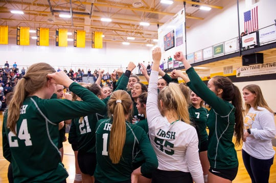 York Catholic players break out of a huddle after winning the third set against Delone Catholic in a District III Class 2A semifinal match at Red Lion on Thursday, Oct. 31, 2019.