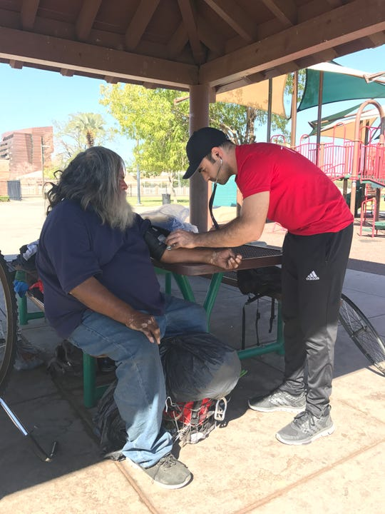 Jeffery Hanna, a graduate student at the UA College of Medicine - Phoenix, provides free health care services to the homeless population through Street Medicine Phoenix.