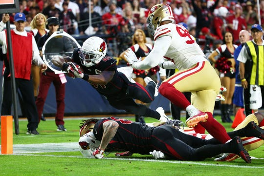 Arizona Cardinals running back Kenyan Drake (41) dives for a touchdown over San Francisco 49ers cornerback Richard Sherman (25) in the first half during a game on Oct. 31, 2019 in Glendale, Ariz.