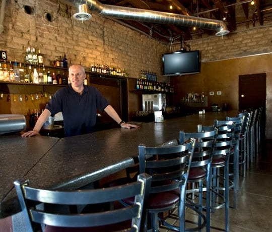 Peter Mahoney stands at the bar at the Old Pueblo Cafe and Bar in Litchfield Park on June 9, 2008.