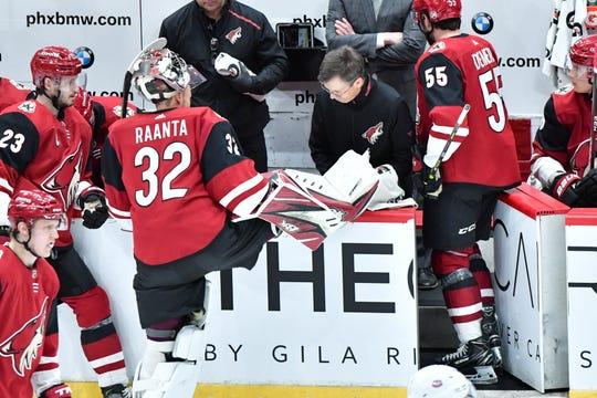 Arizona Coyotes goaltender Antti Raanta (32) has his skate examined by head equipment manager Stan Wilson.