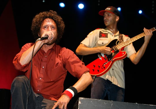 "Zack De La Rocha (L) and Tom Morello from the band ""Rage Against the Machine"" perform during day 3 of the Coachella Music Festival held at the Empire Polo Field on April 29, 2007 in Indio, California."