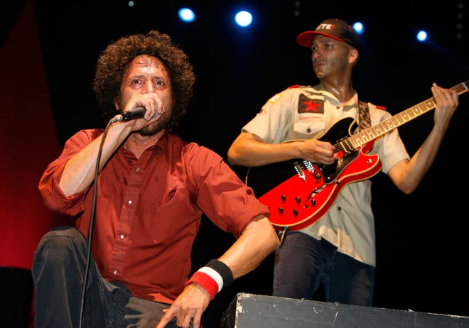 "Zack De La Rocha (L) and Tom Morello from the band ""Rage Against the Machine"" perform during day three of the Coachella Music Festival held at the Empire Polo Field on April 29, 2007, in Indio, California."