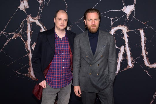 """Filmmaker Mike Flanagan (left) and actor Ewan McGregor attend the premiere of """"Doctor Sleep"""" on Oct. 29, 2019, in Los Angeles."""