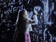 """Waterlight Graffiti"" is an electrical canvas, where visitors use water to draw or write ephemeral messages of light on a wall of 32,000 LEDs."