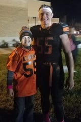Aiden Pilgrim and Jacob Hausmann snap a photo together after one of the Almont football team's games this season.