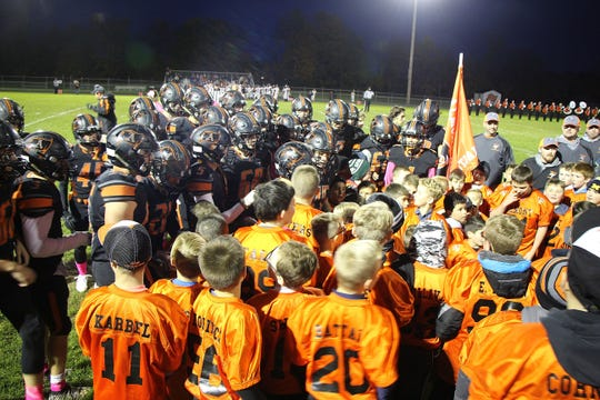 "Almont's youth players does a ""breakdown"" before the varsity football game on Friday, Oct. 25, 2019."