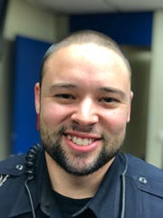 "A member of the Port Huron Police Department participates in ""No Shave November"" last year."