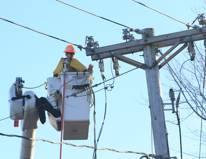 A utility crew begins to repair downed lines on Sheafe Road in the Town of Poughkeepsie on November 1, 2019.