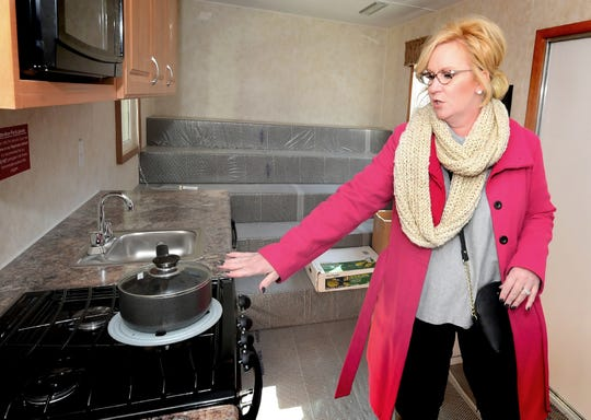 Lisa Altland talks about the kitchen area in the new York City fire safety unit Friday, Nov. 1, 2019. She and her husband, Greg Altland, a retired York City assistant fire chief, were instrumental in procuring the educational trailer. It was dedicated during First Friday events. Bill Kalina photo