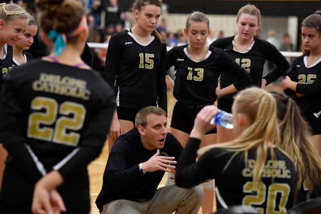 Jason Leppo is seen talking to his Delone Catholic girls' volleyball team during the 2019 season. Leppo has stepped down after a successful run as the Squirettes' head coach.