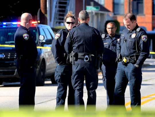 Police gather in the 700 block of South Pine Street after a shooting occurred Friday, November 1, 2019. Bill Kalina photo