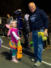Dixie Anthony, 6, dressed as a Pegasus, plays one of the games at Yerington Vineyard Fellowship's Night of Light event.