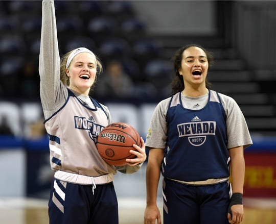 Nevada's Jená Williams, left, and Miki'ala Maio cheer on teammates as they perform drills during media day at Lawlor Events Center on Thursday Oct. 31, 2019.