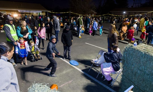 Families enjoy the different games and entertainment at Yerington Vineyard Fellowship's Night of Light event.
