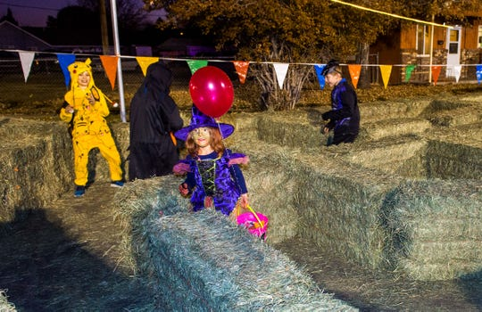 Kids find their way through a maze of hay bales at Yerington Vineyard Fellowship's Night of Light event.
