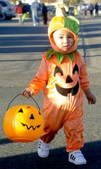 Phu Vay, 1, gets ready to trick-or-treat.