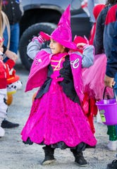 Yadhira Flores, 6, looks for her next trunk-or-treat venue to visit.