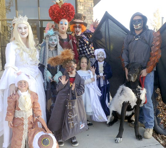 The Greenlach and Silveira families went all-out on joint Alice in Wonderland-themed costumes.