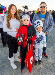 Raymond Monahan, 11, and Malakai Monahan, 7, pose for a photo during trunk-or-treating with their parents Samantha and Jacob Monahan.