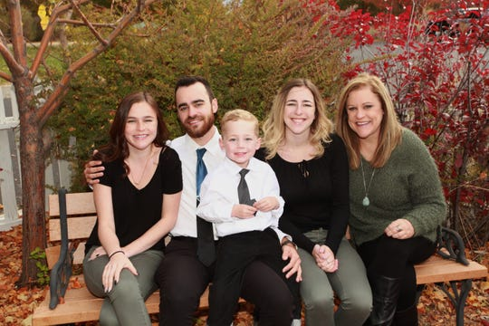 Katie Coombs is pictured with her family.