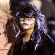 Allison Isakasen, 9, watches some of the games being played at the Yerington Vineyard Fellowship's Night of Light event.
