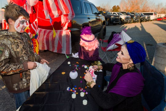 Johnny Fink, 11, trick-or-treats Jessica Rader, a fortune teller.