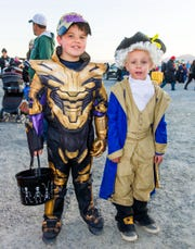 Logan Nelson, 7, left, and Peyton Dini, 7, participate in the trunk-or-treat at Wild West Chevrolet.