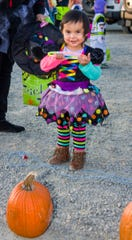 Juliette Diaz, 2, prepares to do a ring toss game.