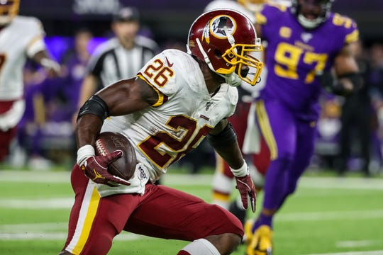 Washington Redskins running back Adrian Peterson (26) carries the ball during the second quarter against the Minnesota Vikings on Oct. 24.