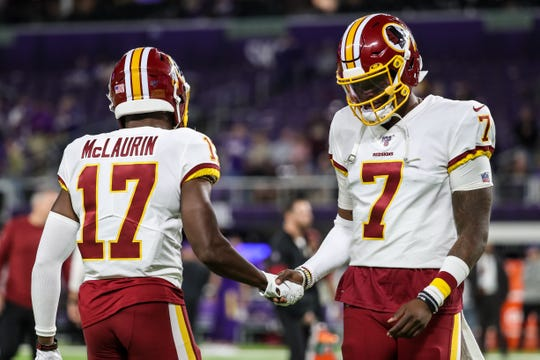 Washington Redskins quarterback Dwayne Haskins talks with wide receiver Terry McLaurin prior to the game against the Minnesota Vikings.